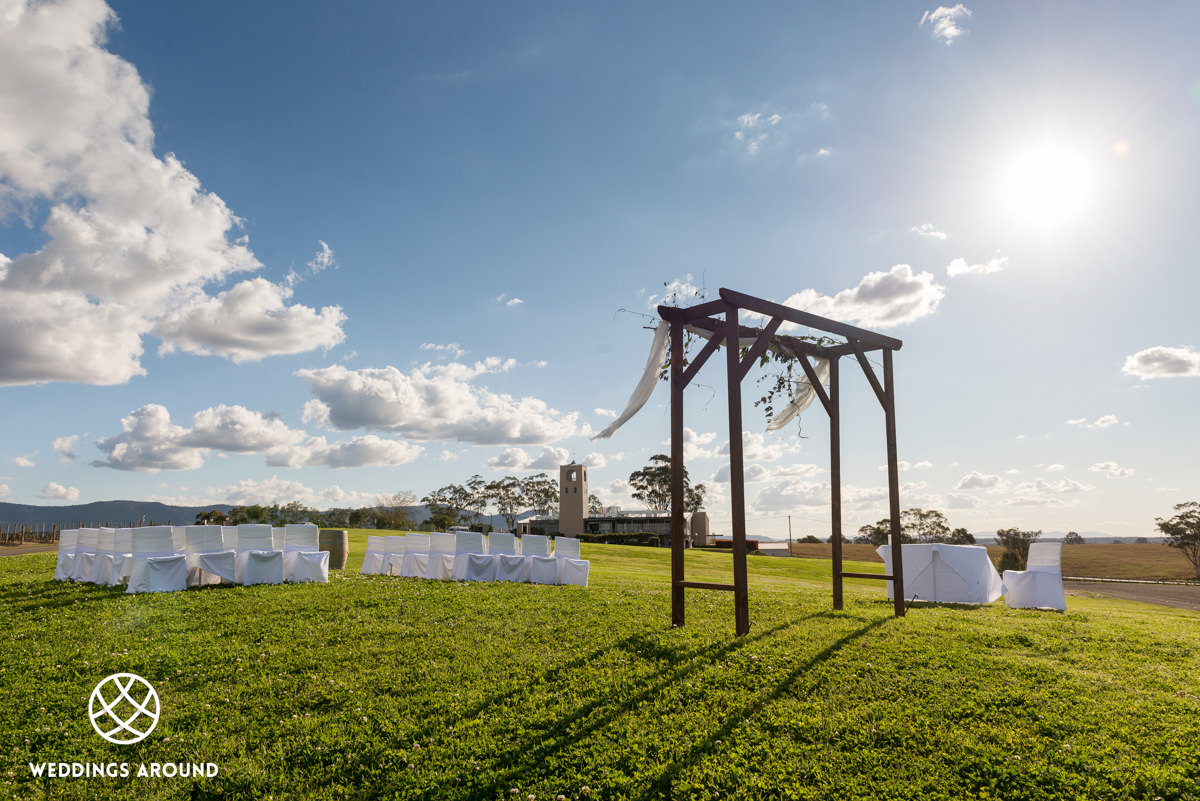 Wedding Ceremony with the bell-tower as a backdrop